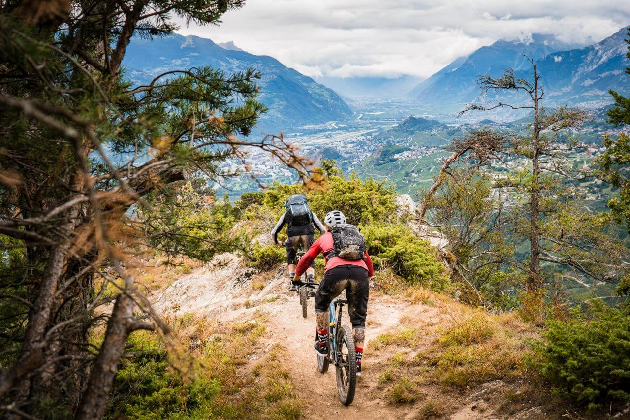 2 mountainbiker riding from crans montana towards sion